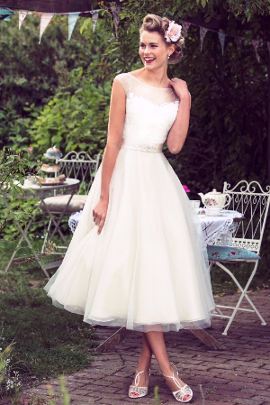 3afea2aecf8d A rum pink tea length wedding dress with a retro edge featuring a lace  bodice with subtle beading, a full 50's inspired skirt and a wide satin.