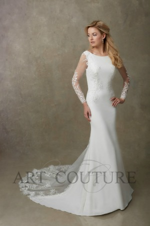 03f631adecc A sleek stretch crepe sheath style wedding dress featuring sheer lace long  sleeves