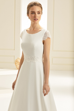 9245d28e227c A beautiful quality, A-line chiffon wedding dress featuring delicate lace  cap sleeves, a wide lace band to the waist and a low cut V-back.
