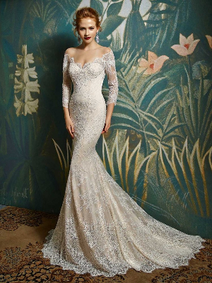 2277b29c381 ... this beaded Chantilly lace and tulle wedding dress featuring 3 4 length  sleeves