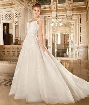 168938dc6fc ... lace and tulle princess style wedding dress features a sweetheart  neckline