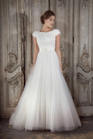 6e08bd0fc An glorious tulle, princess wedding dress featuring a tightly fitted bodice  embellished with jewelled flowers, a satin bow to the waist, cap sleeves  and a ...