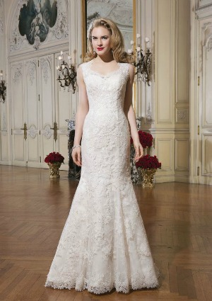 0c4a5ad0389f An delicate lace over organza mermaid style wedding dress featuring a Queen  Anne neckline, a sheer illusion back with lace and button detail and long  sheer ...