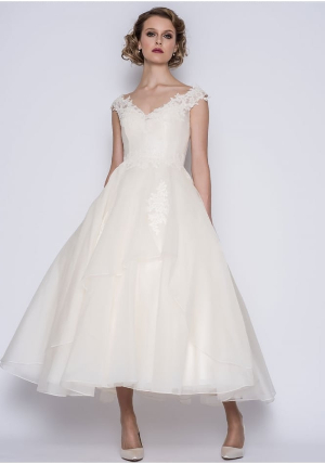 44e79bb8907 A vintage inspired 50 s length silk organza and lace wedding dress  featuring a V-neck