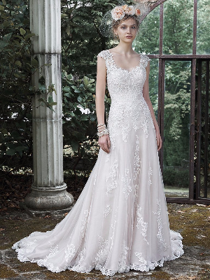 18463b915974 A lace applique over tulle, A-line wedding dress featuring exquisite lace  cascading down the bodice and full skirt, an illusion neckline and cap  sleeves, ...