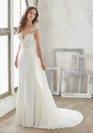 80cd862e5f60 A chic crepe sheath style wedding dress with Alencon lace applique detail,  an illusion neck and low cut back and a detachable chiffon train.