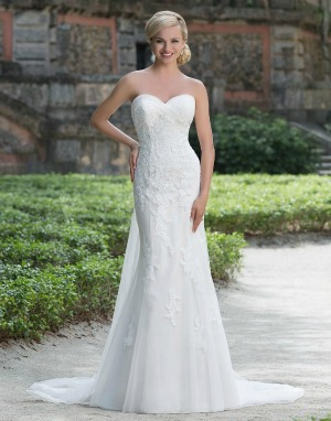 b6c86d685695 A romantic lace over tulle fit and flare wedding dress featuring a  sweetheart neckline with contrasting tulle trim and a detachable train.