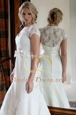 bcf13bd96ca0d A classic corded lace wedding dress that flows off the hips into a medium  length train. The gown features delicate lace caps sleeves and beautiful  lace back ...